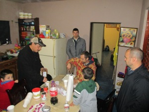 Eating in a believer's home. Mr E is on the left.