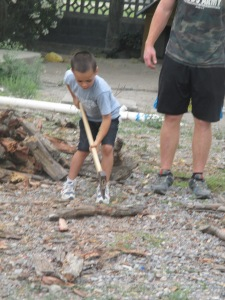 Ethan working hard chopping wood for the fire that the food was cooked over