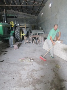 Getting the barn ready. Why was I sweeping while the boys got to chop wood!?