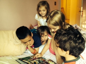kids with grace and gwen reading action bible